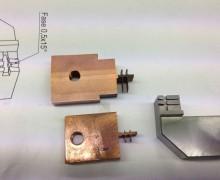 Vereinzelungsgreifer mit zugehörigen Erodier-Elektroden