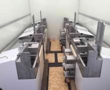 4 Automatisierungseinheiten mit integrierten Liften im LKW